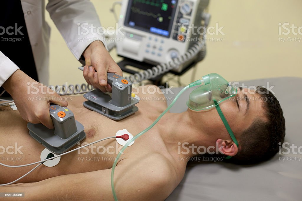Cardiac massage being oven to patient stock photo