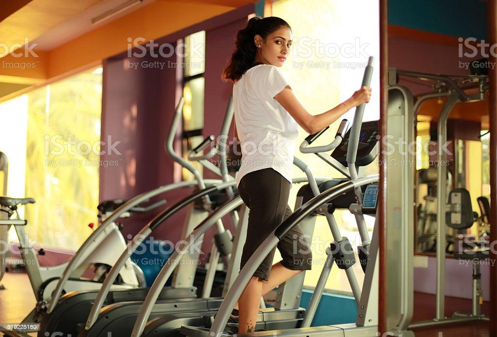 Cardio Machine Workout in Gym stock photo