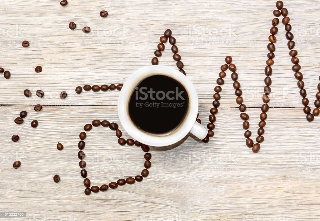 cardiogram and heart laid out coffee beans stock photo