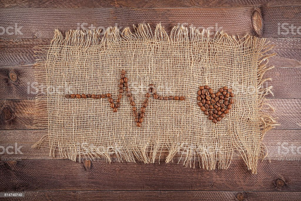 cardiogram of coffee beans on sacking stock photo