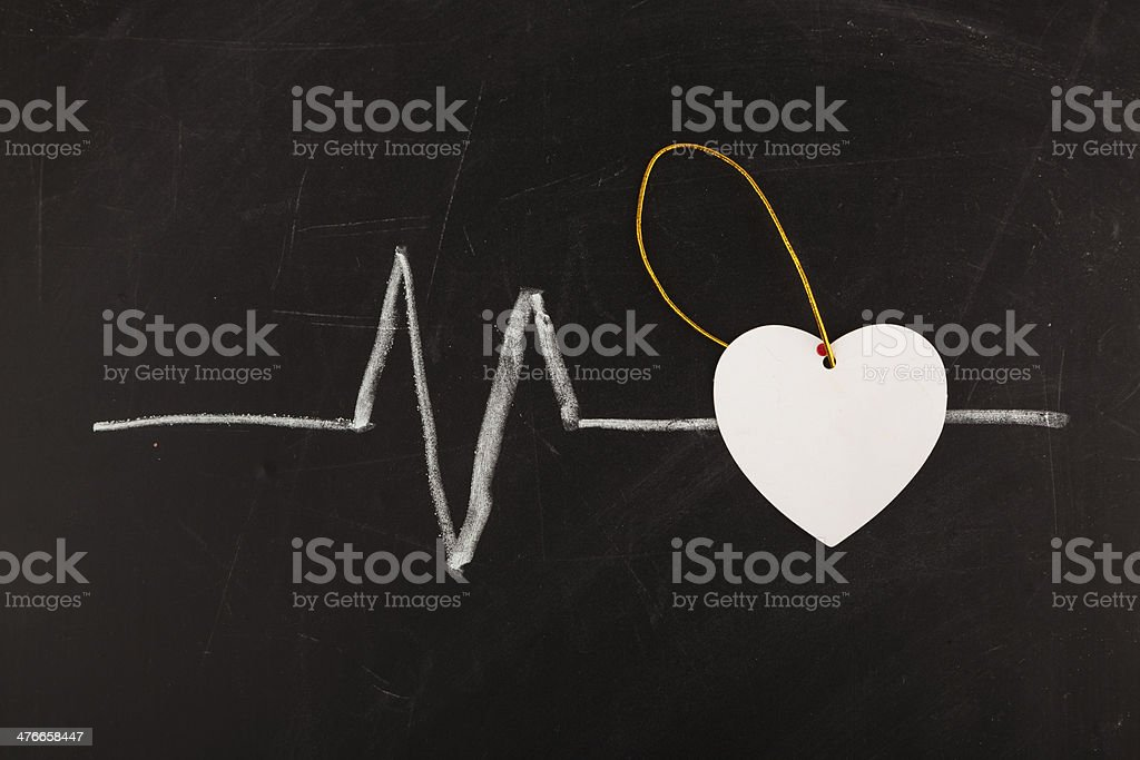 cardiogram with white heart stock photo