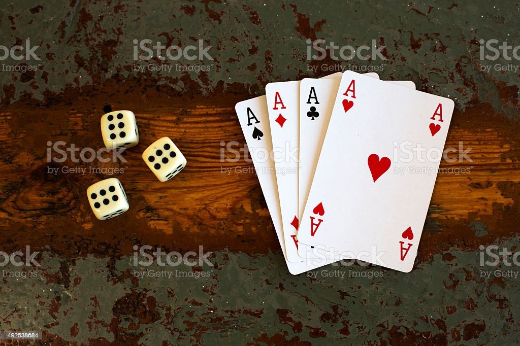 cards '4 aces' and dice stock photo
