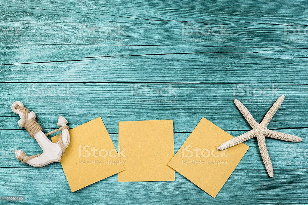 cards, anchor and sea star on azure background stock photo