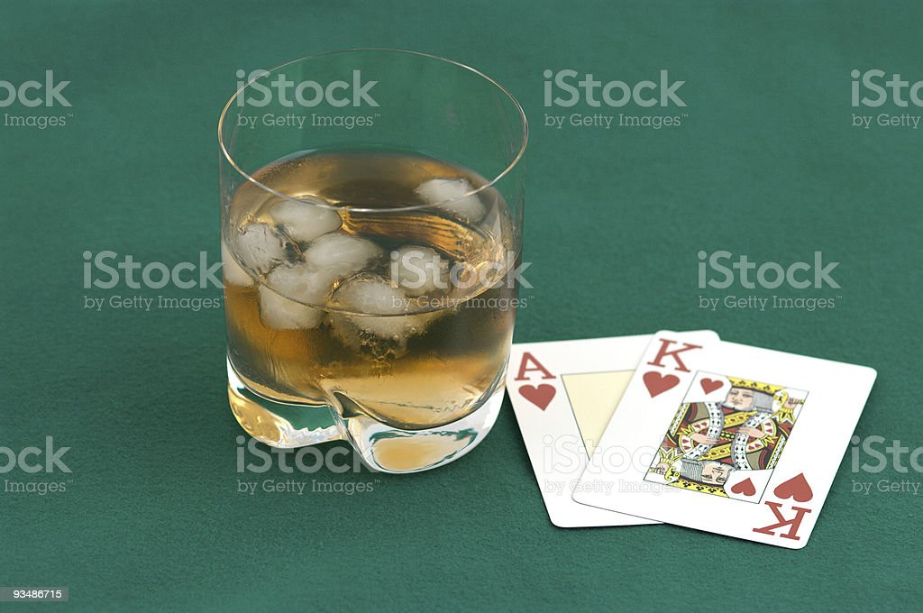 Cards and a glass of whisky. royalty-free stock photo