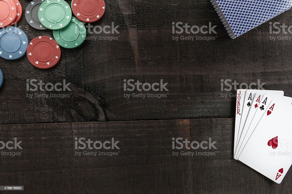 Cards and poker chips on wooden background stock photo