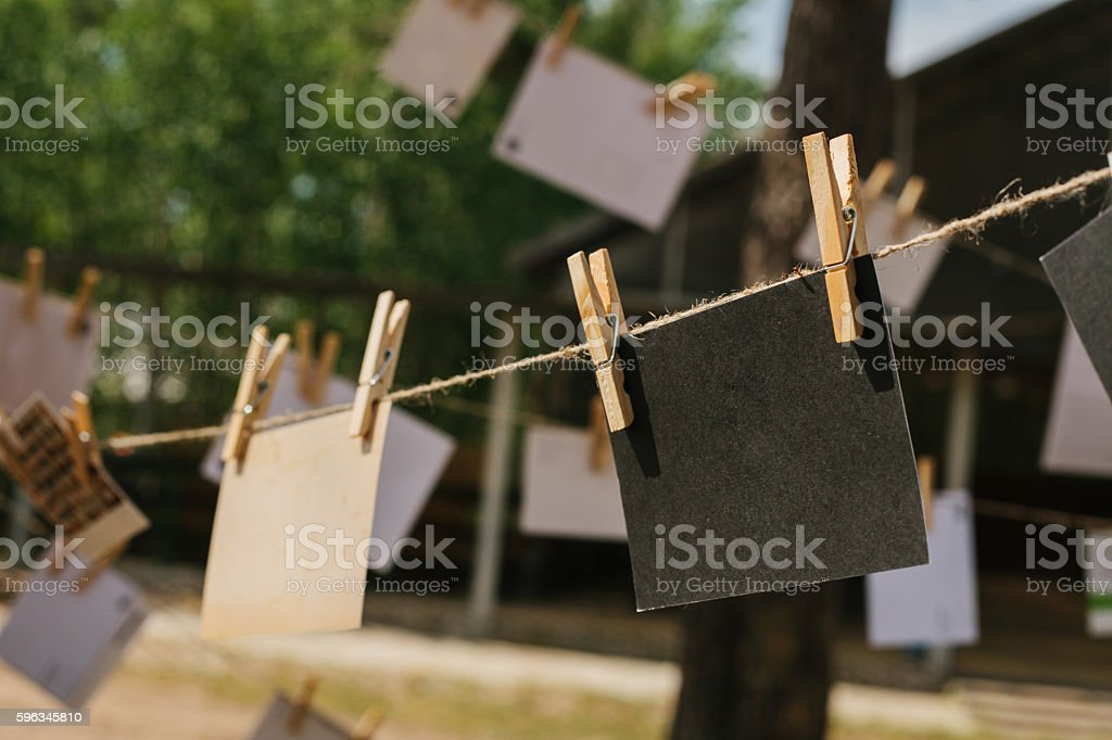 Cards hang on a rope. Conceptual background. The festival outdoors. stock photo