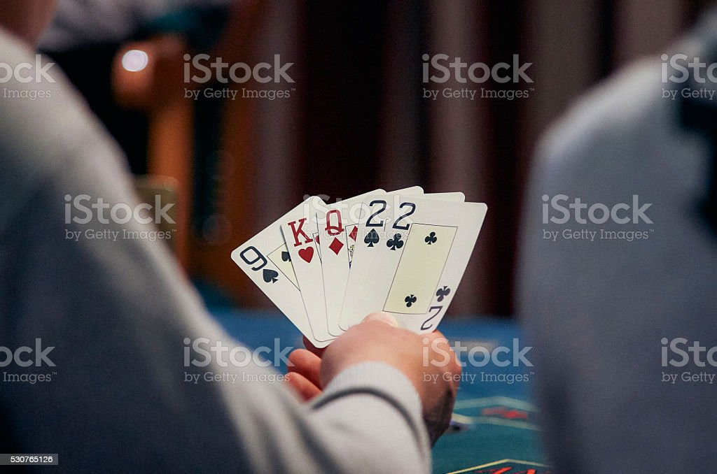 Cards in player's hand stock photo