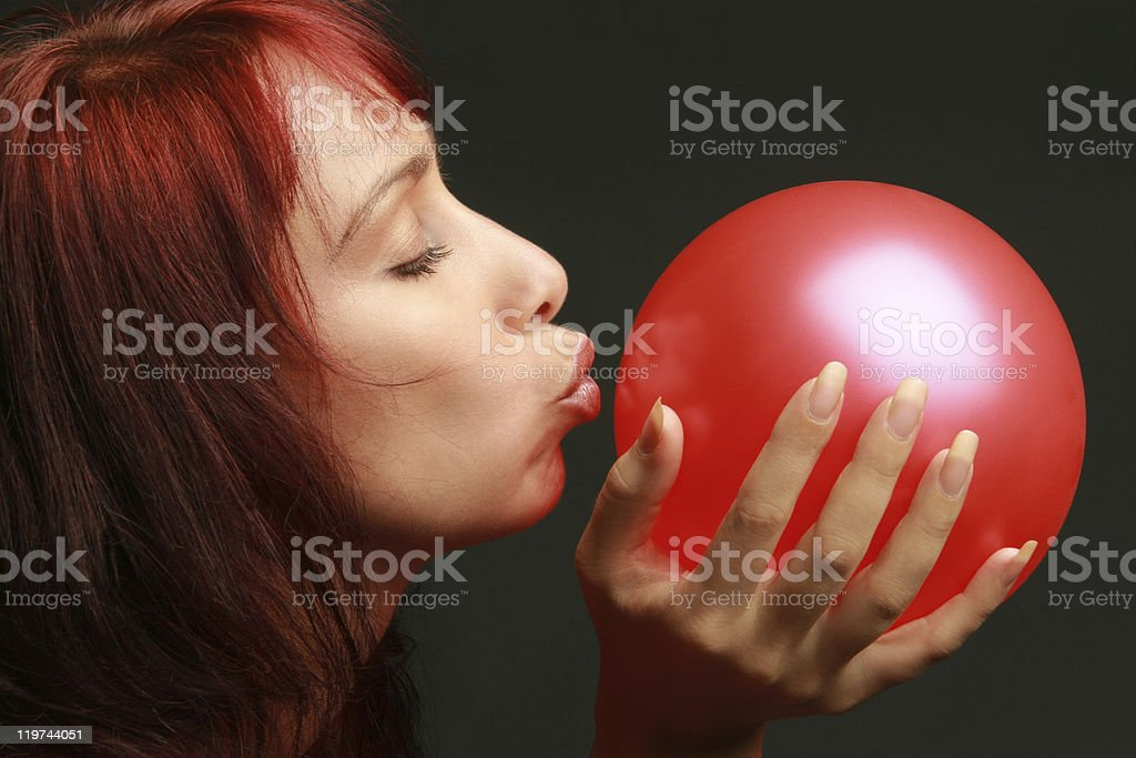Care concept. Woman with red balloon royalty-free stock photo