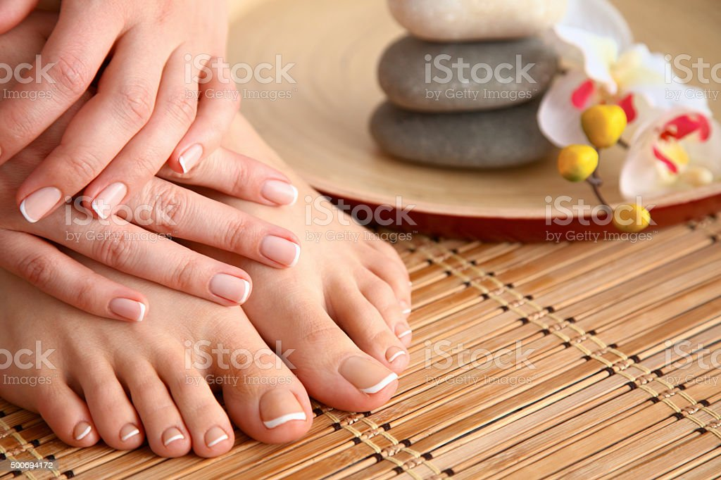 Care for beautiful woman legs on the floor stock photo