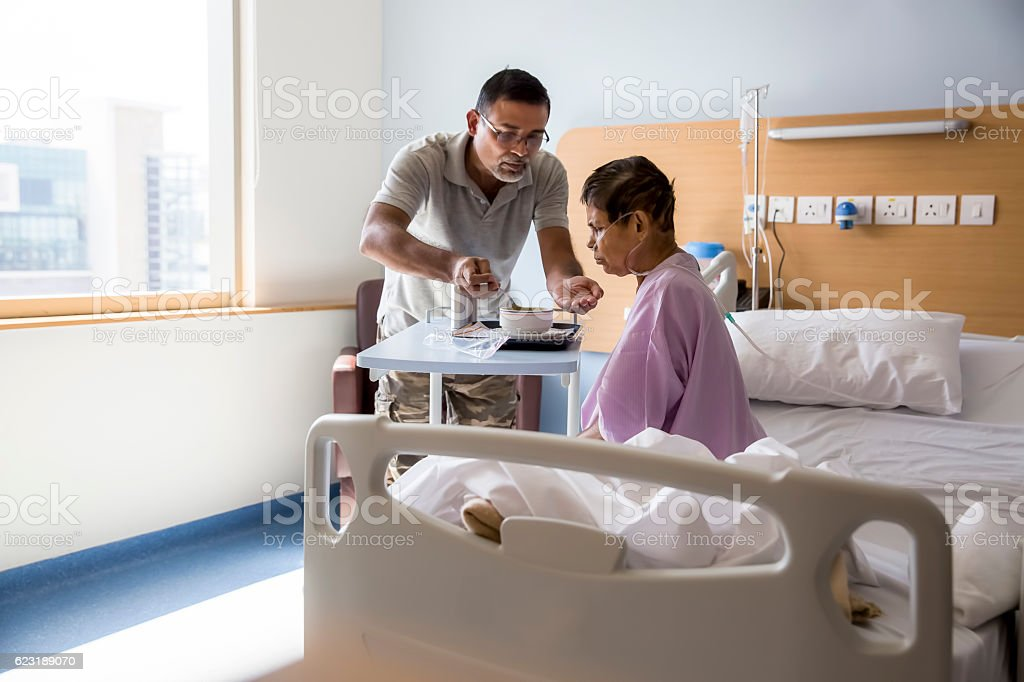 Care for Old woman patient in Hospital stock photo