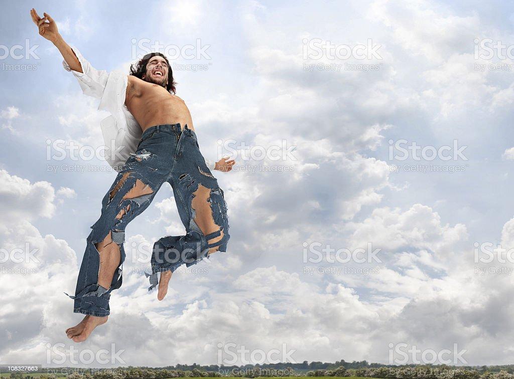 care free man wearing torn jeans enjoying freedom stock photo