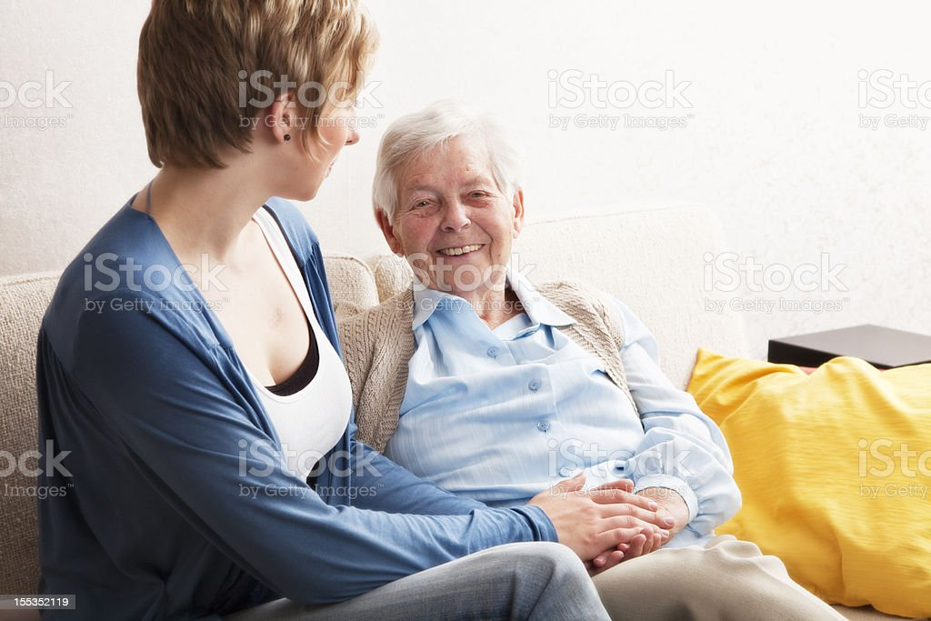 care giver and happy  senior woman  holding hands royalty-free stock photo