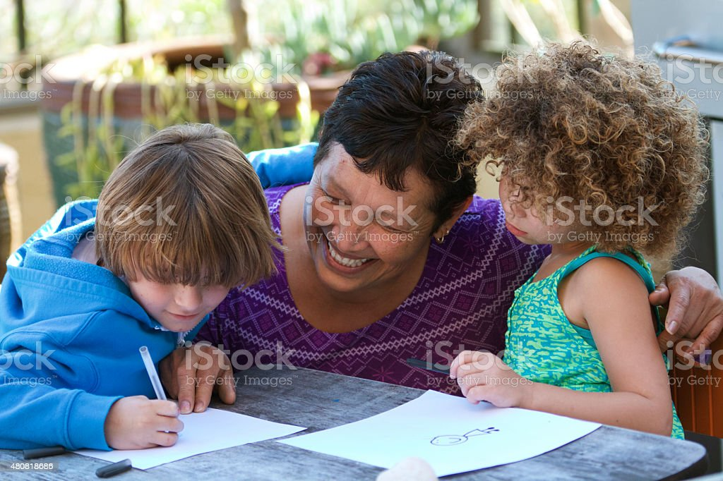 Care giver teaching stock photo