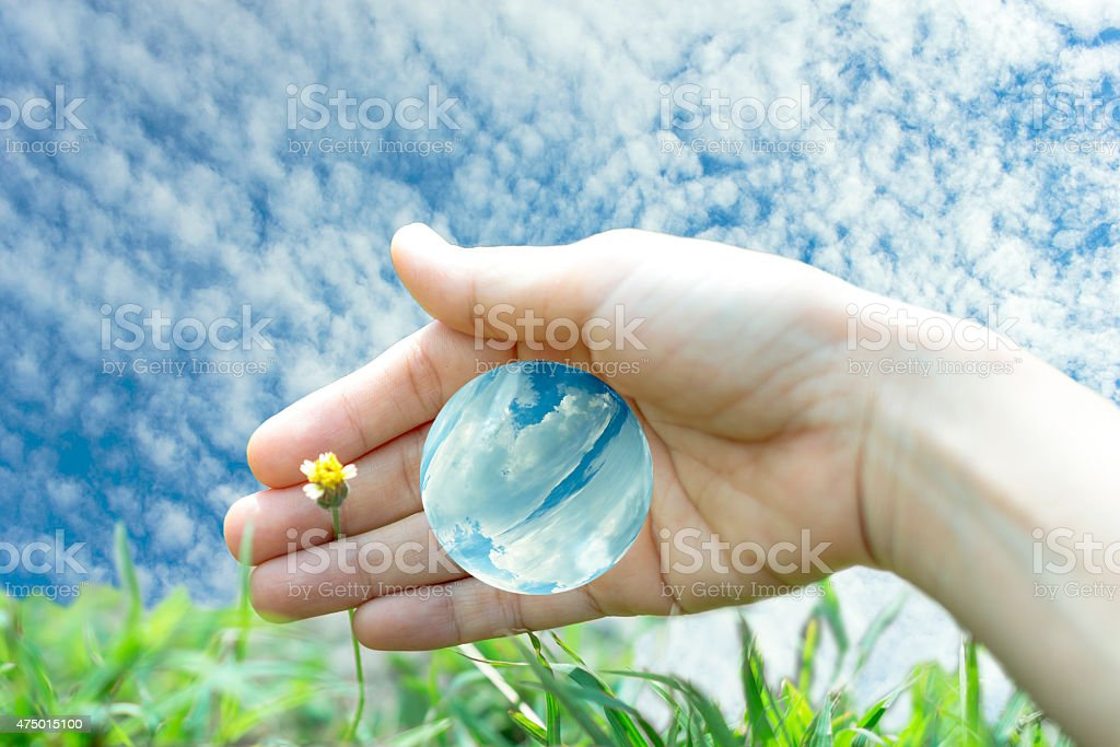 Care the blue world and nature with human hand royalty-free stock photo