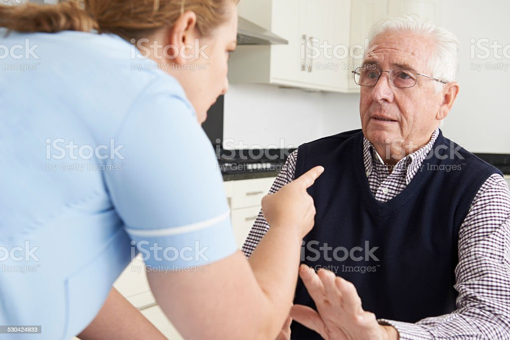 Care Worker Mistreating Elderly Man stock photo