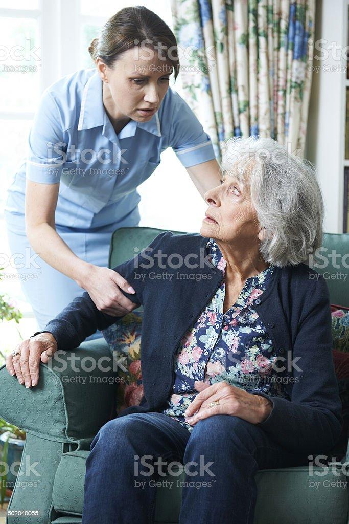 Care Worker Mistreating Senior Woman stock photo