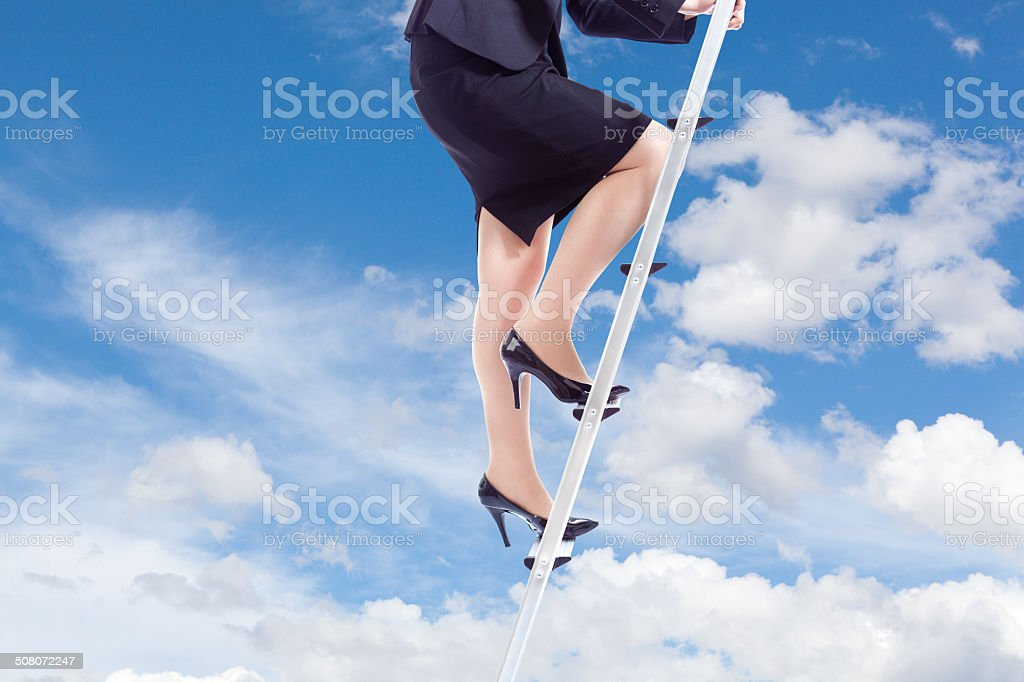 Career Business Woman Climbing the Corporate Ladder into the Sky stock photo