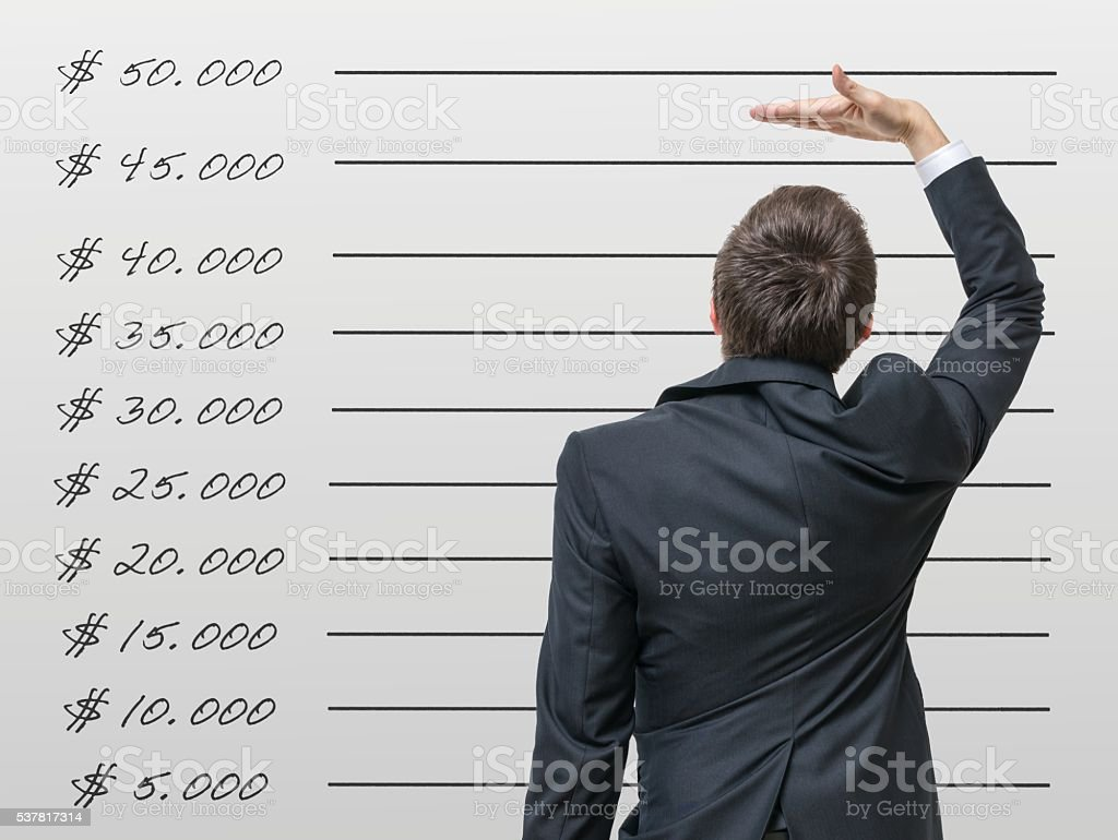 Career concept. Man is comparing his income with average wage. stock photo