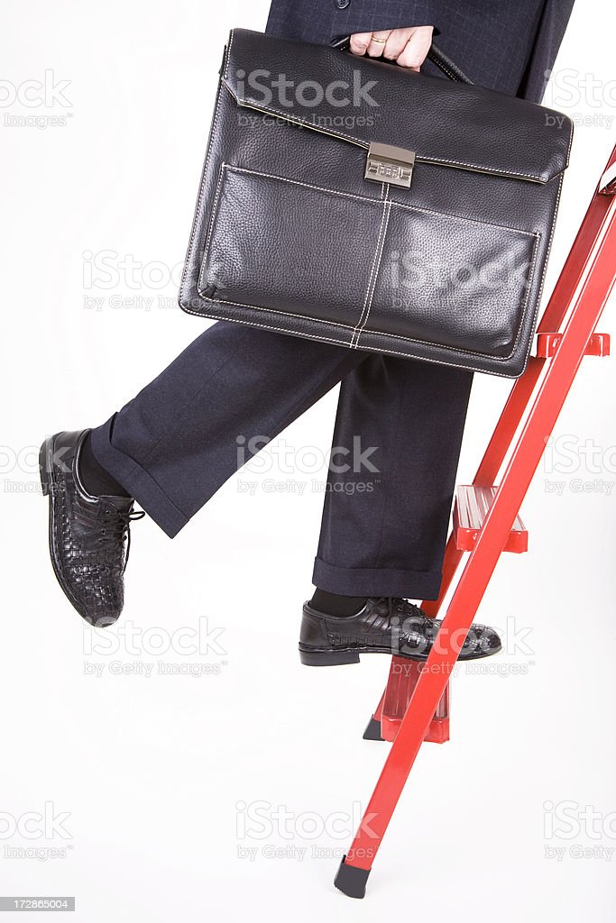 Career Steps Concept, Businessman Climbing Ladder, Holding Briefcase, Low Section royalty-free stock photo