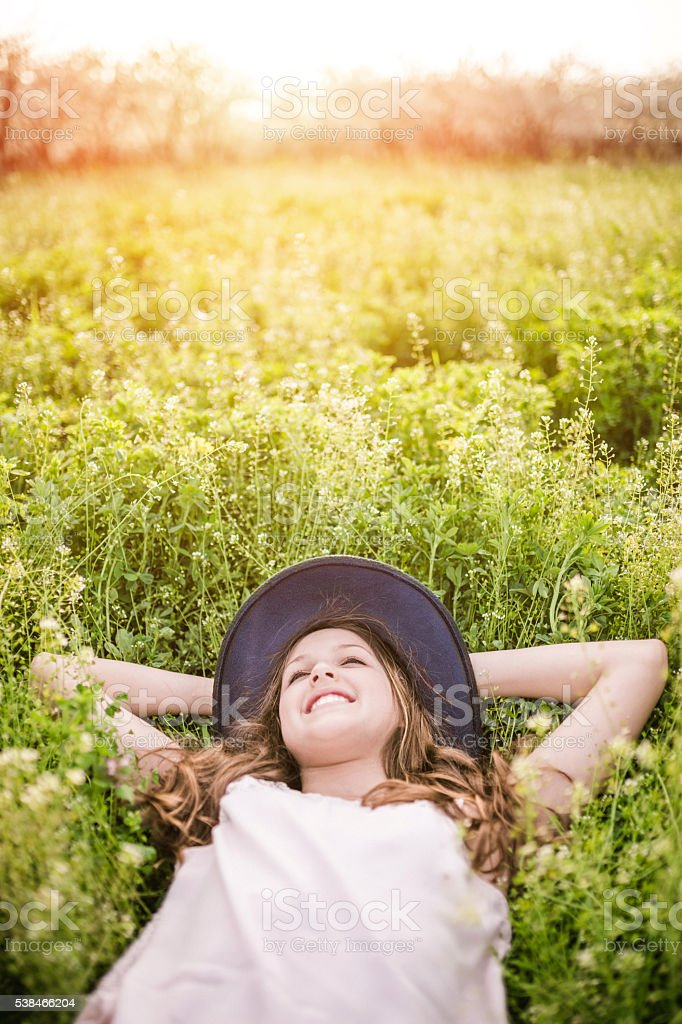 Carefree and smiling girl stock photo