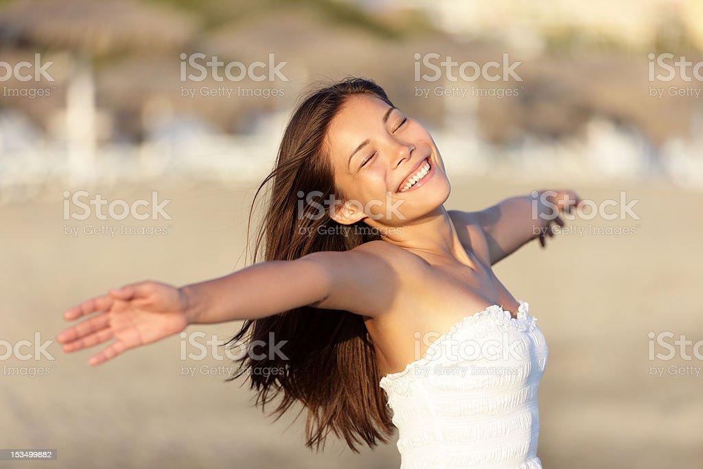Carefree beach woman happy royalty-free stock photo
