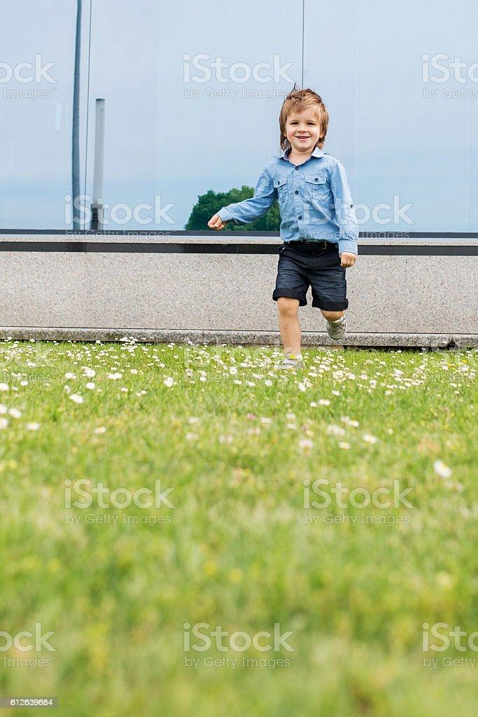 Carefree boy having fun outdoors. stock photo