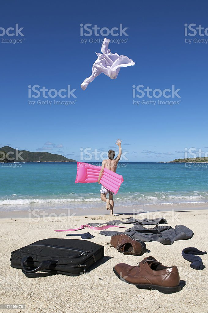 Carefree Businessman Runs to Vacation Throwing Suit on the Beach royalty-free stock photo