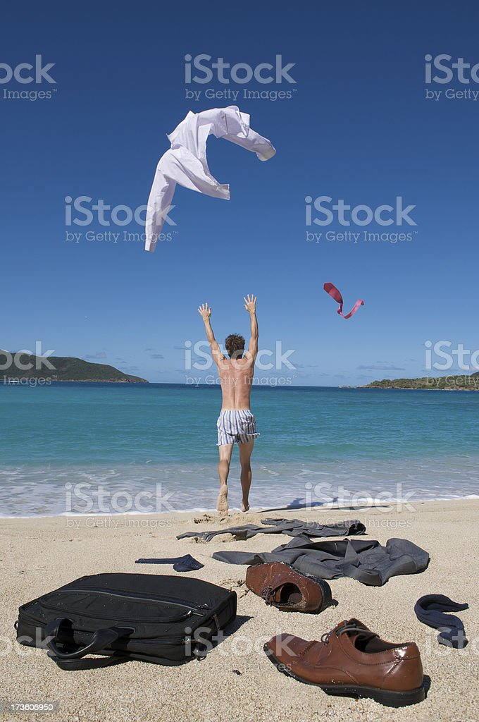 Carefree Businessman Throwing Shirt and Tie to the Sky stock photo