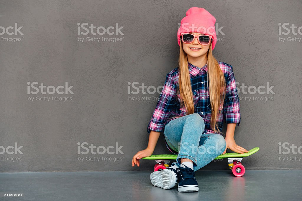 Carefree cutie with skateboard. stock photo