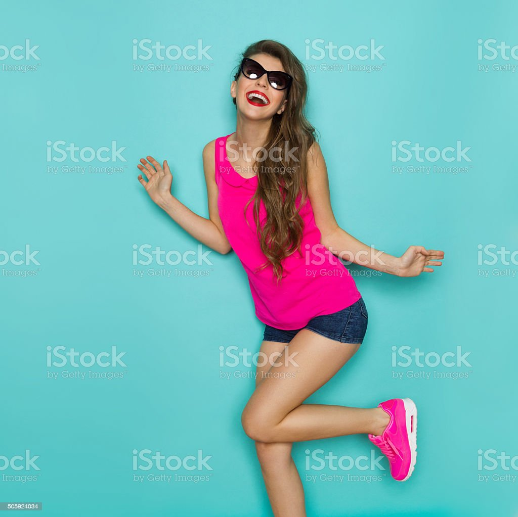 Carefree Girl Dancing In Pink Top stock photo