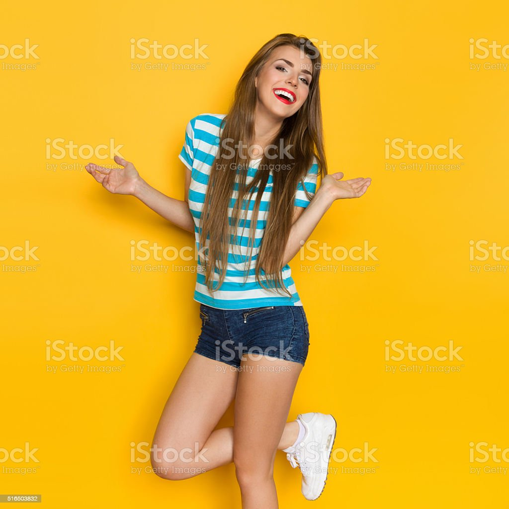 Carefree Girl Dancing On One Leg stock photo