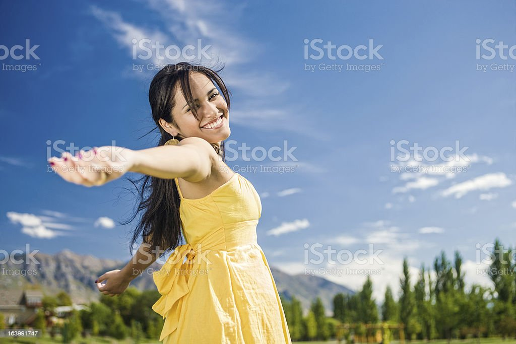 Carefree Girl Twirling Around stock photo