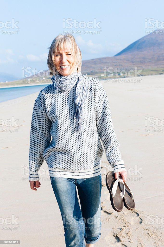 Carefree, happy woman on Luskentyre beach stock photo