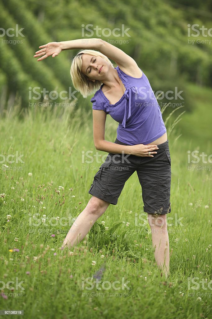 Carefree Healthy Active Woman - Relaxing and Stretching royalty-free stock photo
