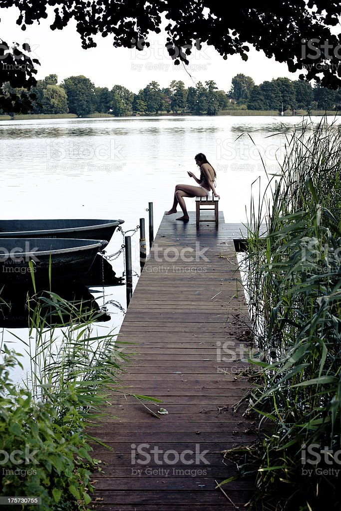 carefree summer day: teenage girl sits on a yetty royalty-free stock photo