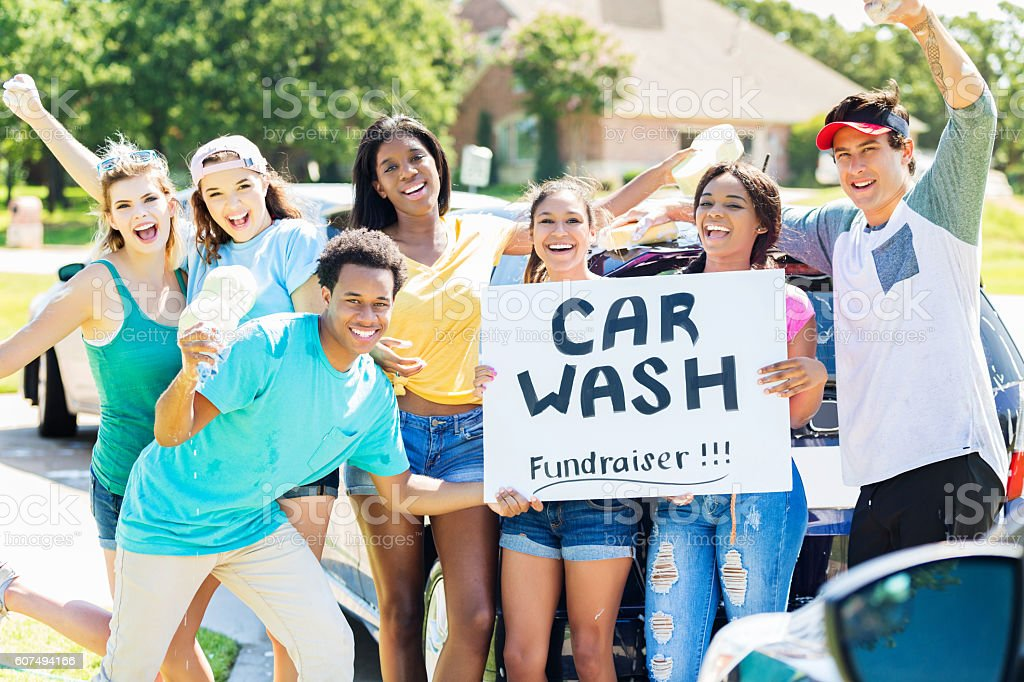 Carefree teenagers organize charity car wash stock photo