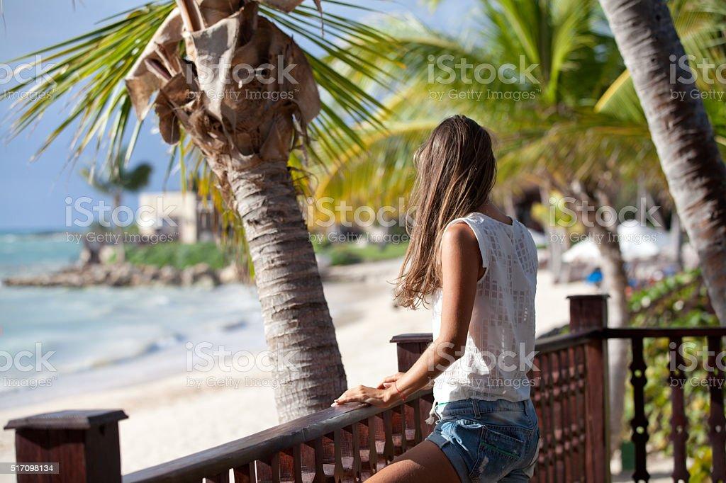 Carefree tourist is enjoying vacation at beach. stock photo