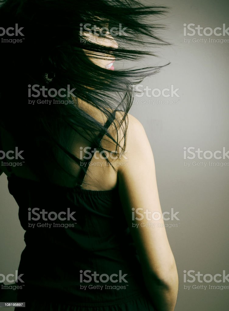Carefree young asian women flipping her hair royalty-free stock photo