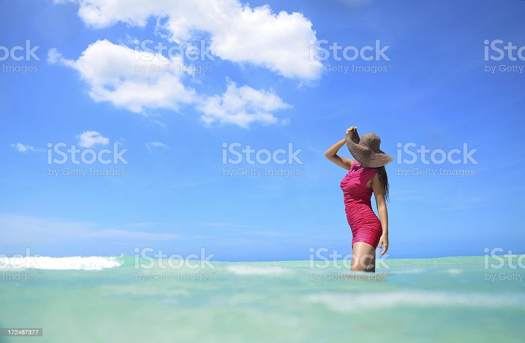 Carefree young woman relaxing in the water royalty-free stock photo