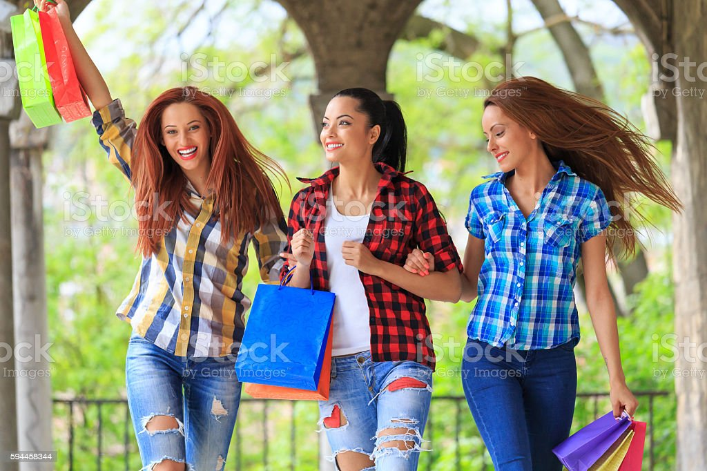 Carefree young women enjoying their purchases stock photo