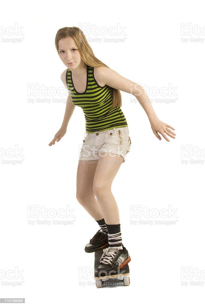 Careful girl on the skateboard. royalty-free stock photo