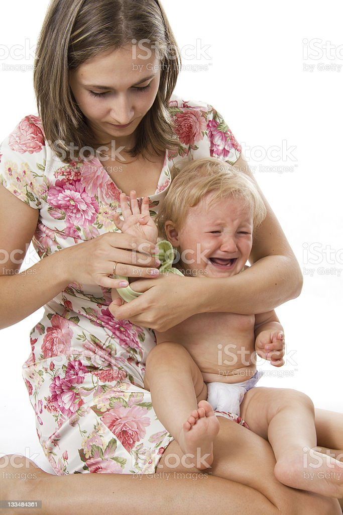 Careful mother dresses the daughter stock photo
