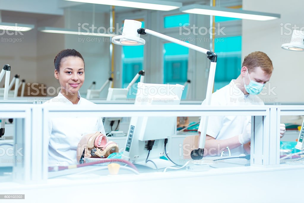 Careful students in modern dental office stock photo