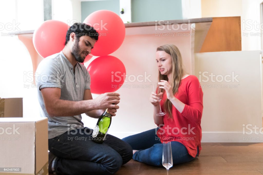 Careful, the Champagne is going to overflow stock photo