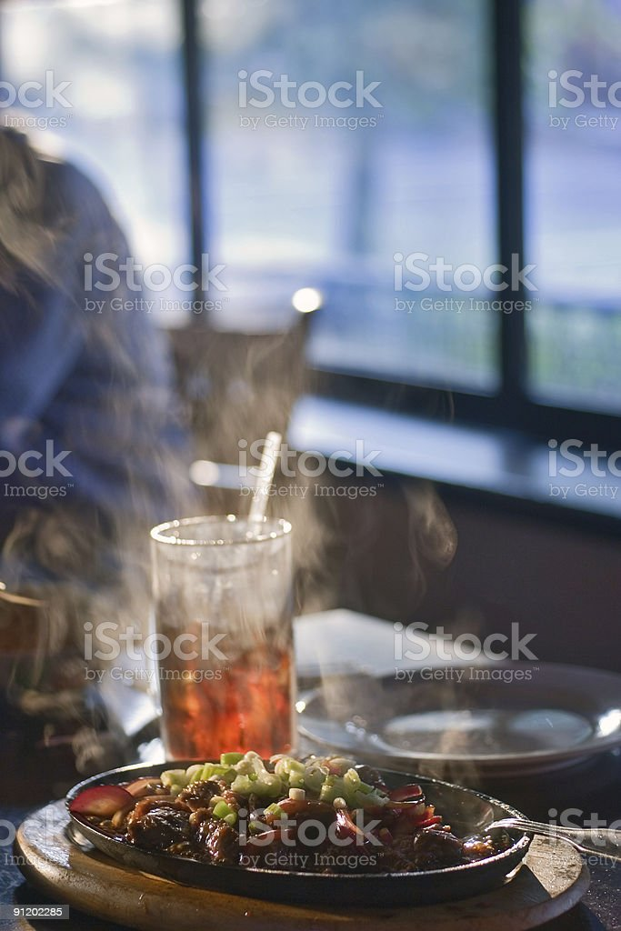 Careful - the thai malaysian food is steaming hot stock photo