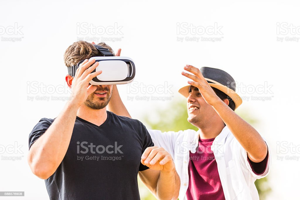 Careful with the new VR console! Let me help you! stock photo