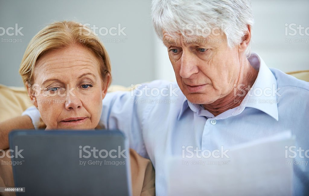 Carefully considering all of their options stock photo