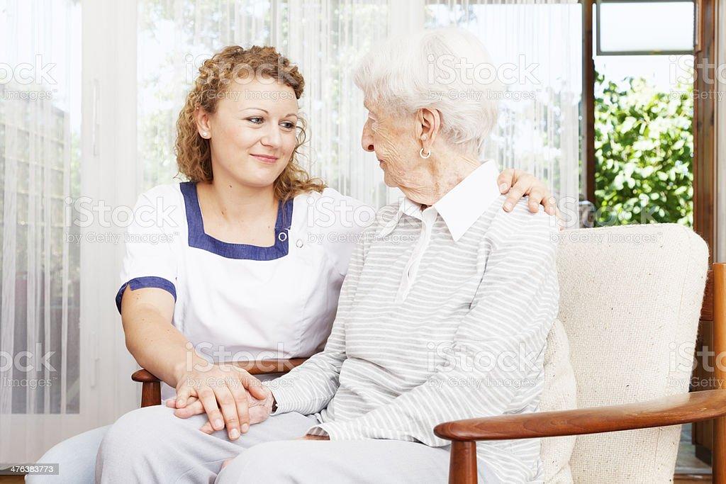 caregiver and senior woman bonding royalty-free stock photo
