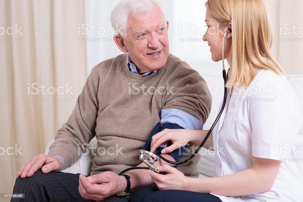 Caregiver checking the hypertension stock photo