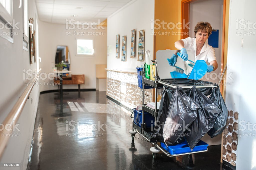 Caregiver Cleaning In The Retirement Community stock photo